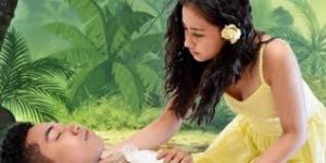 Ti Moune (Brianna Clark) tends to Daniel (Michael Gnansounou) in Once on This Island.