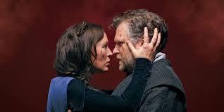 Lady Macbeth (Moya O'Connell) and Macbeth (Ben Carlson) confer intensely.
