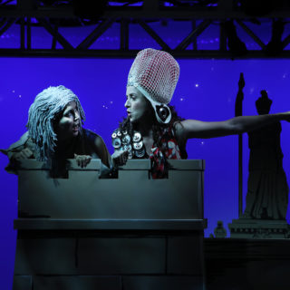 Two characters wear Barbara Clayden's improvised hats in Lysistrata at Bard on the Beach.