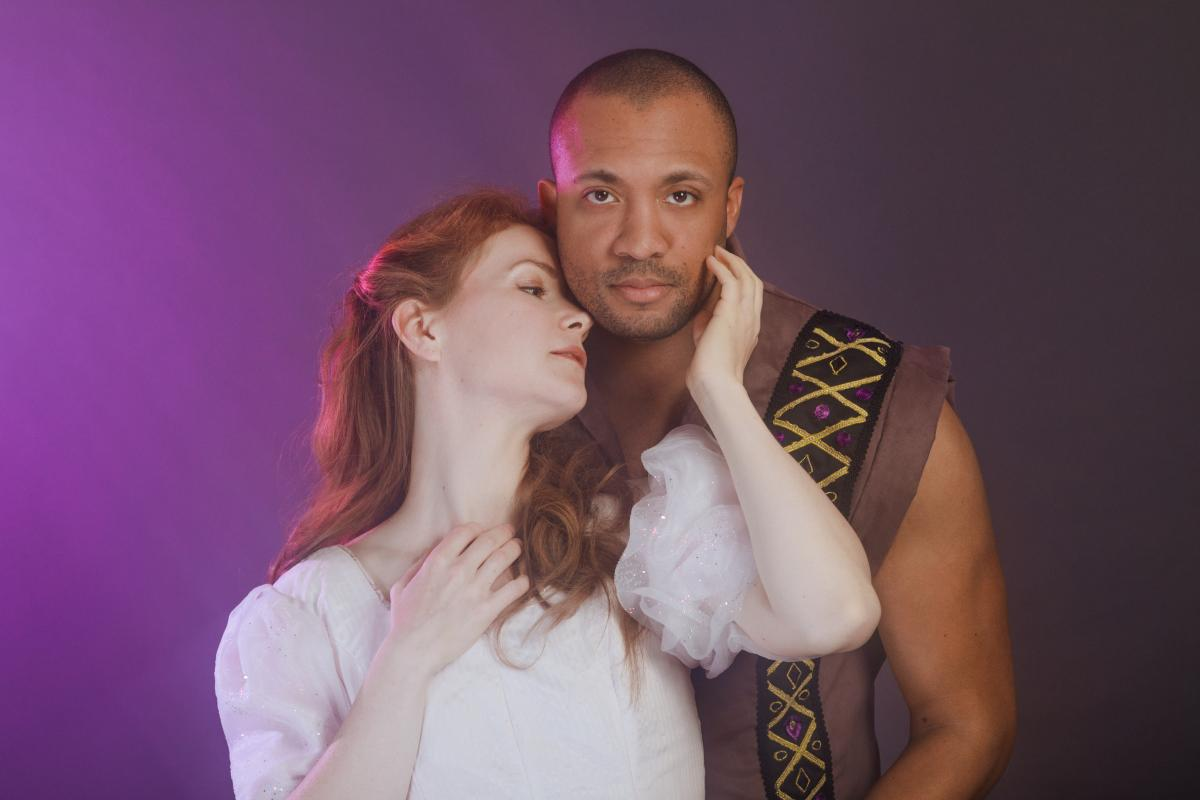 Cinderella (Mallory James) and Tré Cotton (Topher) embrace in Cinderella at Theatre Under the Stars.